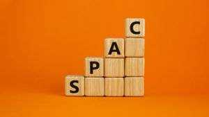 An image of a series of cubes stacked to grow larger as they go to the right, with the word SPAC on it.